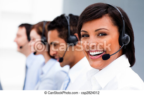 Attractive young woman working in a call center  - csp2824012