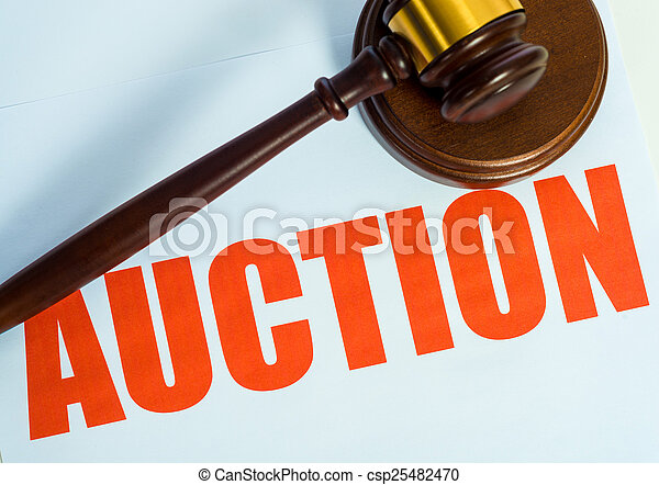 Auction sign and mallet on a white background - csp25482470
