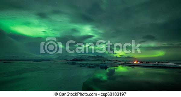 Aurora borealis over Jokulsarlon lagoon in Iceland - csp60183197