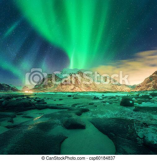 Aurora over snowy mountains. Northern lights - csp60184837