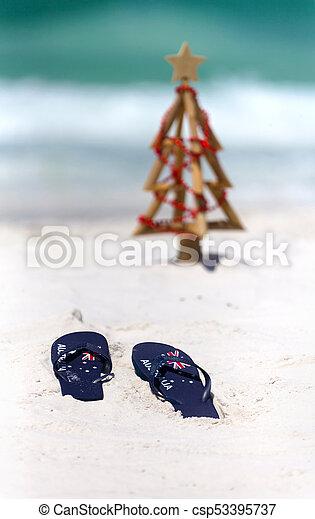 Christmas In Australia Background.Australia Flag Thongs On A White Sandy Beach At Christmas