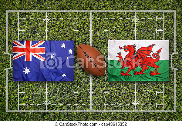 Australia vs. Wales flags on green rugby field