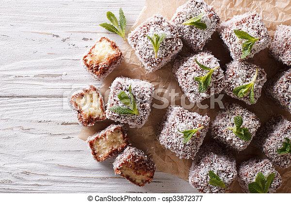 Australian Lamington cake with coconut. Horizontal top view - csp33872377