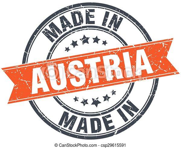 Austria orange grunge ribbon stamp on white - csp29615591