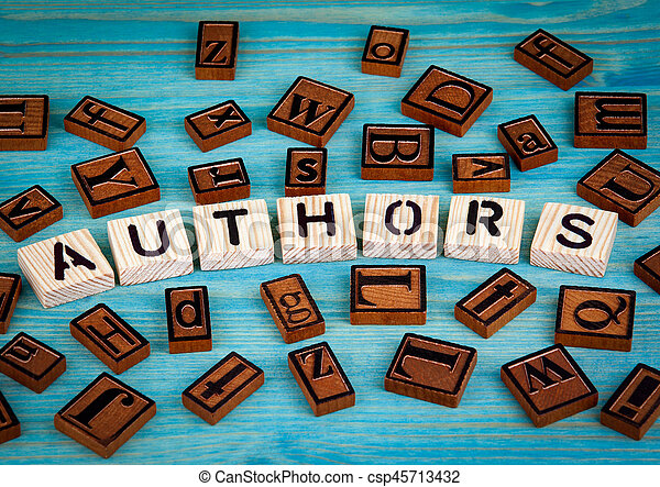 authors word written on wood block. Wooden alphabet on a blue background - csp45713432