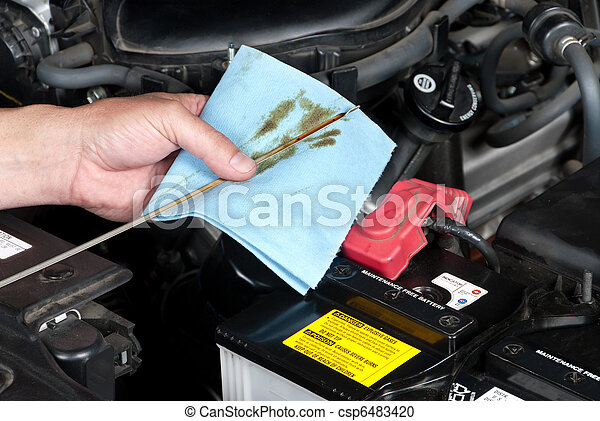 Auto Mechanic Checking Oil - csp6483420