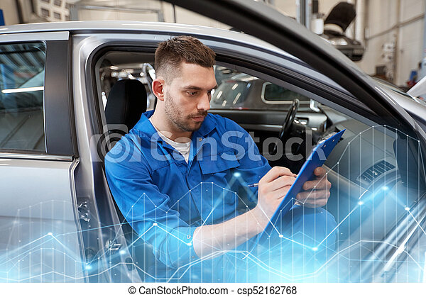 auto mechanic man with clipboard at car workshop - csp52162768