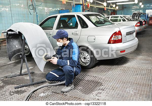auto mechanic polishing car - csp13322118