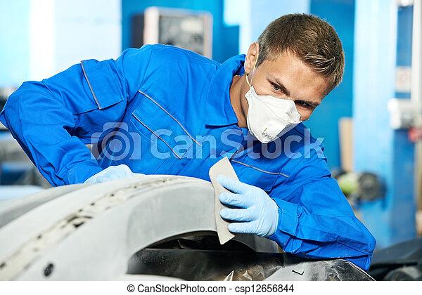 auto mechanic polishing car - csp12656844