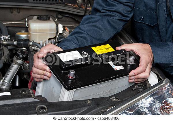 Auto mechanic replacing car battery - csp6483406
