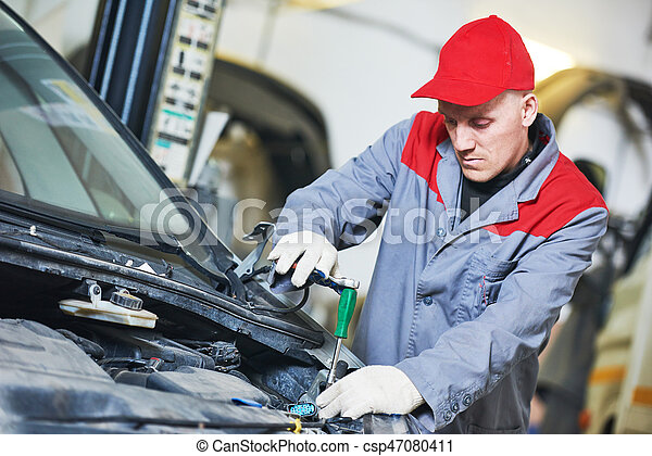 Auto repair service. Mechanic works with spanner - csp47080411