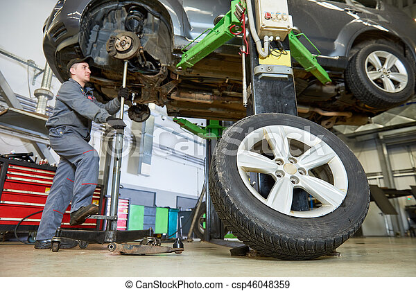 Auto repair service. Mechanic works with car - csp46048359