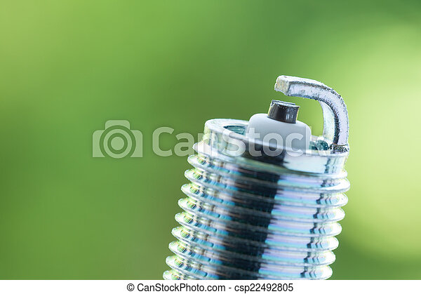 Auto service. New spark plug as spare part of car. - csp22492805