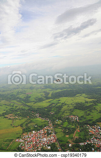 Autogyro flying over the tropical landscape - csp19340179