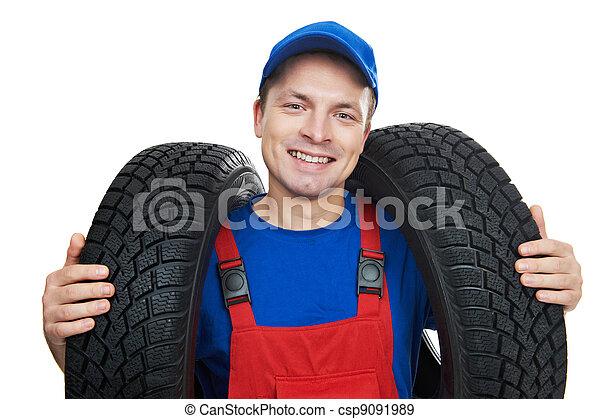 automobile mechanic with car tire - csp9091989
