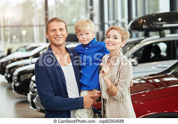 automobile sales centre. young family with child boy in car sell - csp62354588