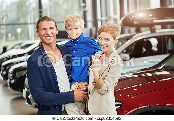 automobile sales centre. young family with child boy in car sell - csp62354592