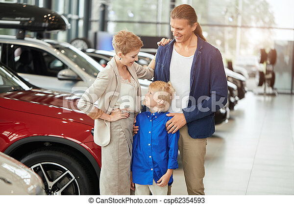 automobile sales centre. young family with child boy in car sell - csp62354593
