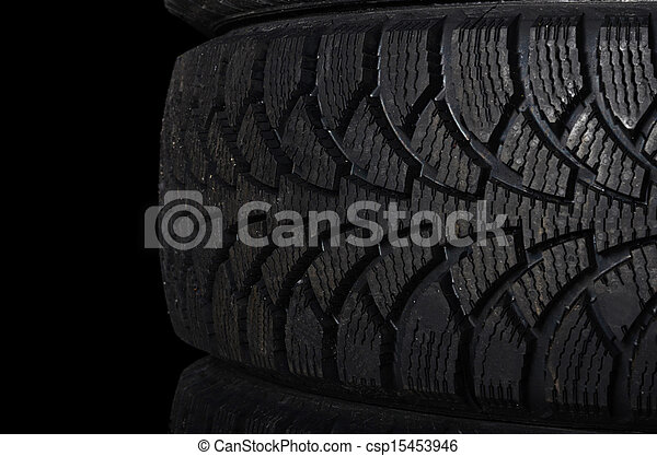 Automobile tire on black background - csp15453946
