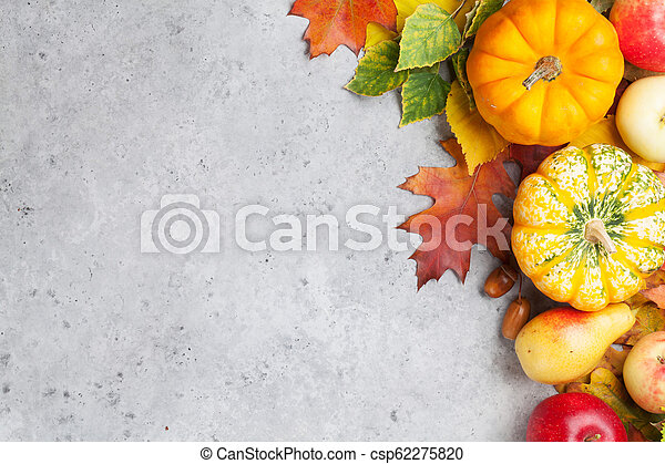 Autumn backdrop with pumpkins and fruits - csp62275820