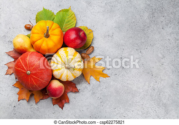 Autumn backdrop with pumpkins and fruits - csp62275821
