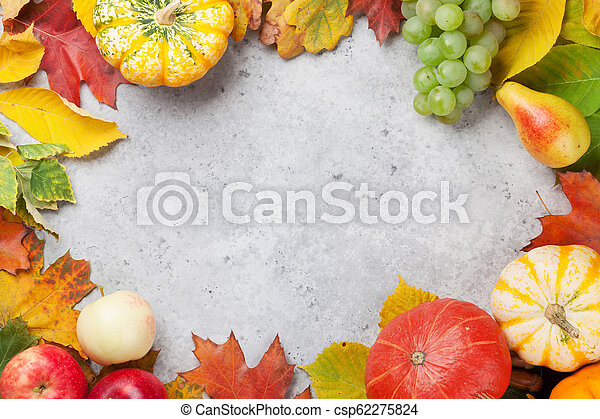 Autumn backdrop with pumpkins and fruits - csp62275824