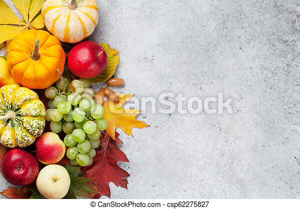 Autumn backdrop with pumpkins and fruits - csp62275827