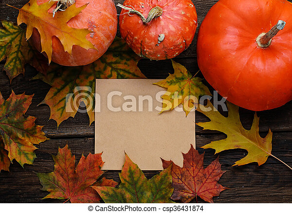 Autumn background with leaves and pumpkin - csp36431874