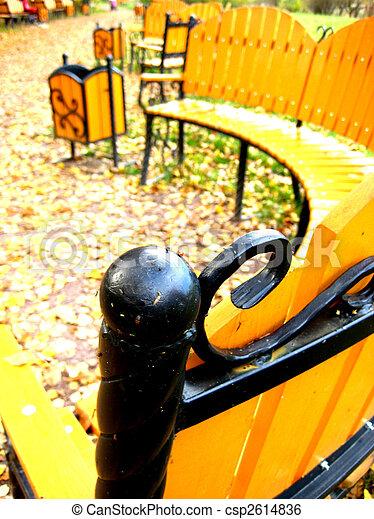 Autumn bench in park - csp2614836