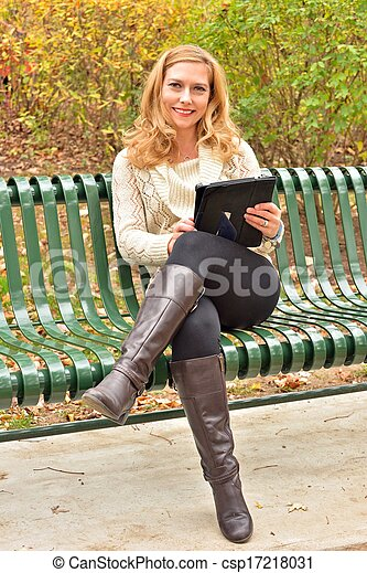 Autumn Blond with Tablet II - csp17218031