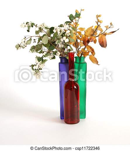 Autumn bouquet in a vase with colored glass on a white background - csp11722346