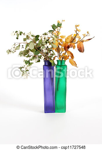 Autumn bouquet in a vase with colored glass on a white background - csp11727548