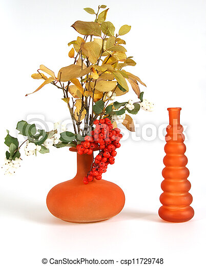 Autumn bouquet in a vase with colored glass on a white background - csp11729748