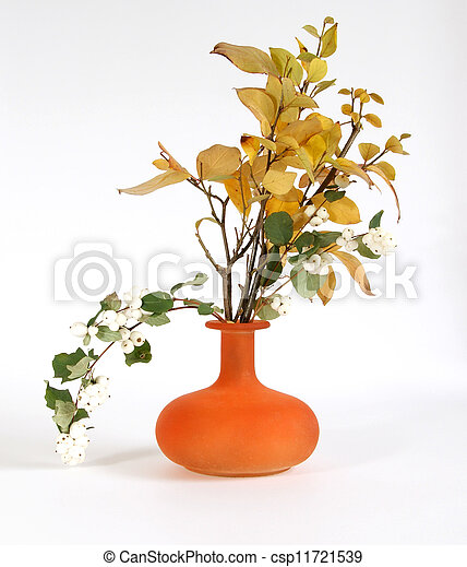 Autumn bouquet in a vase with colored glass on a white background - csp11721539