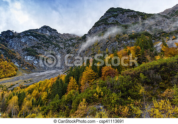 Autumn colorful fall trees high mountains scenery in the Alps - csp41113691