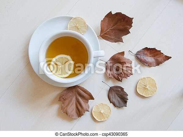 Autumn composition with cup of tea and colorful autumn leaves. Top view, flatlay - csp43090365
