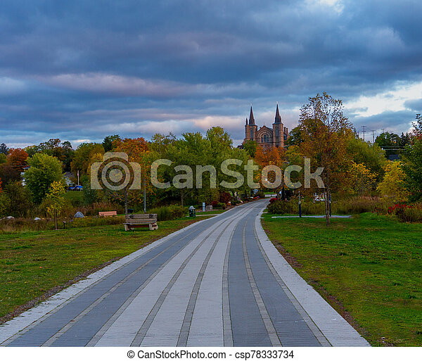 Autumn evening in a city park - csp78333734
