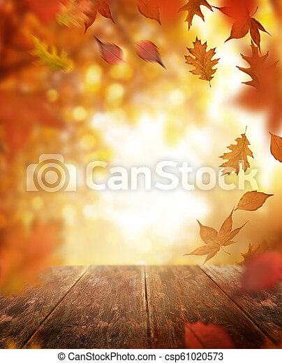 Autumn Falling Leaves and Wooden Table - csp61020573