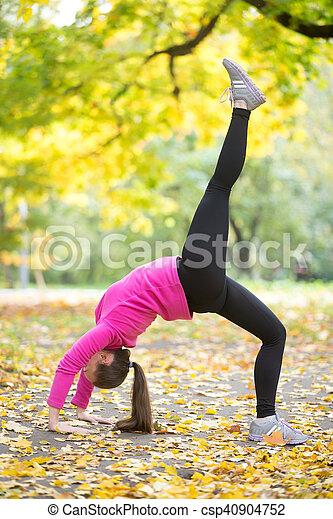 autumn fitness onelegged bridge pose beautiful young