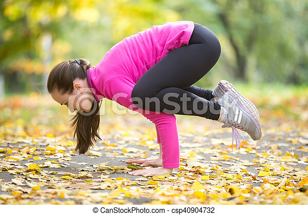 autumn fitness outdoors crane crow pose sporty beautiful