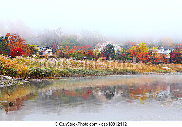 Autumn forest and lake - csp18812412