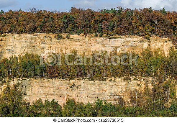 autumn forest and sandstone cliff - csp23738515