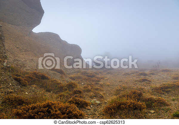 Autumn gloomy landscape on a foggy day in the mountains - csp62625313