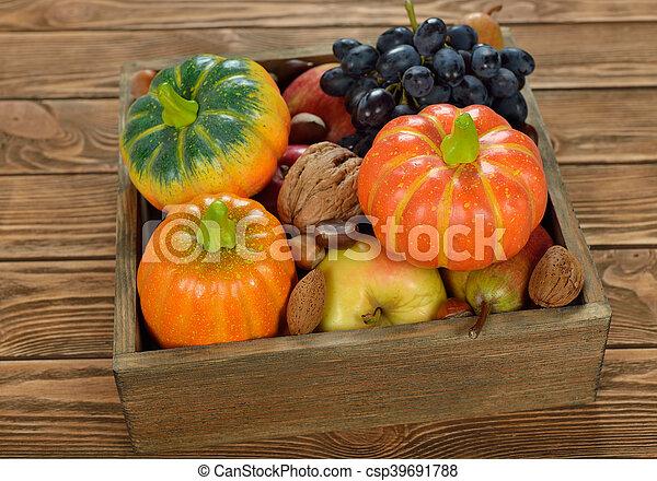 Autumn harvest in a wooden box - csp39691788
