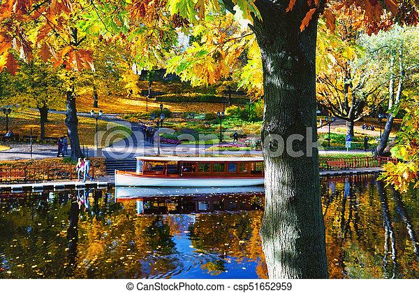 Autumn in the city park of Riga - csp51652959