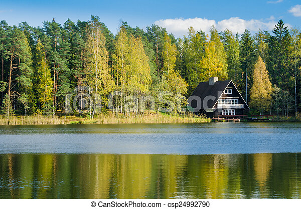 Autumn landscape on the lake in the woods - csp24992790