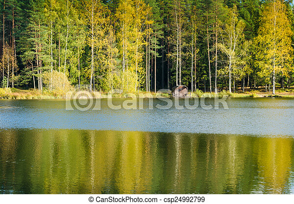 Autumn landscape on the lake in the woods - csp24992799