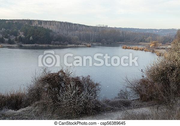 Autumn landscape on the lake. - csp56389645