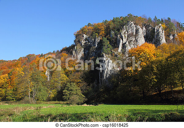 autumn landscape with colorful forest and calcareous rocks - csp16018425