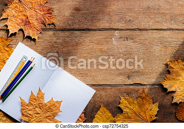Autumn leaves on wooden background with copy space. Wallpaper for September 1. - csp72754325